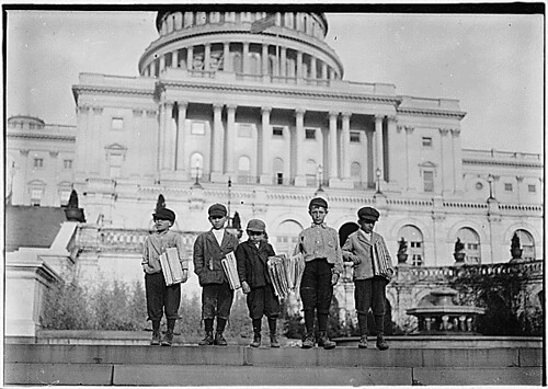 Group of newsies selling on capitol steps. Tony, 8 years old, Dan, 9 years old, Joseph, 10 years old, John, 11 years old. Washington, D.C., 04/11/1912 by The U.S. National Archives