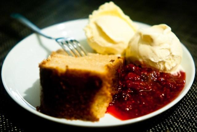 Lemon cake, vanilla ice cream and raspberry sauce