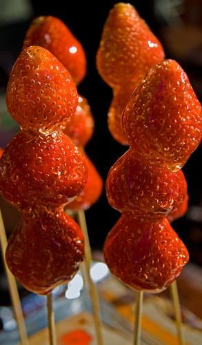 candied strawberries on a stick