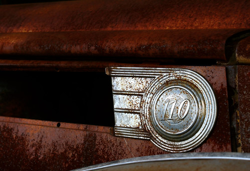 Detail of the silver badging on a rusting 1940 Packard 110 found along Route 66 in Missouri.