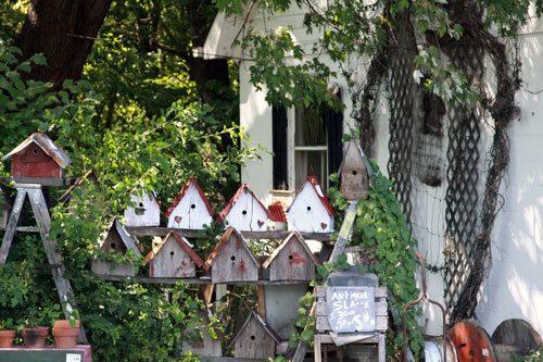 some bird houses with red roofs