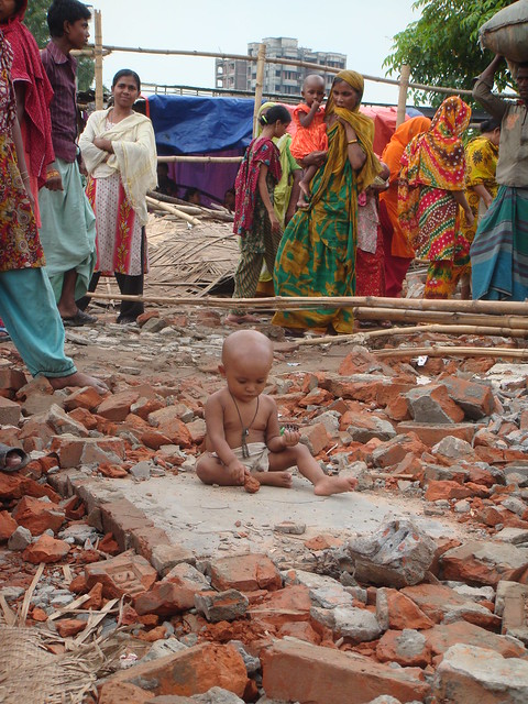 A child is seen playing after the eviction of Sattala slum in Mohakhali, Dhaka.