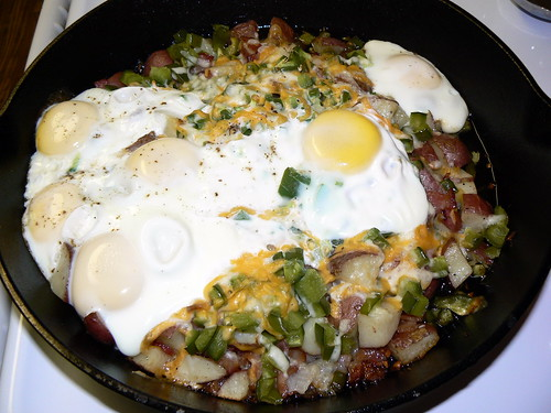 Breakfast bake in our New Cast Iron Skillet: Red potatoes, BACON, Onion, Green Bell Peppers, Garlic, Jalapeños, Topped with Eggs and Cheese