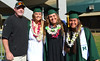 Softball head coach Bob Coolen with graduates Kristin Cheney (student manager), Heather Morales and Ulu Matagiese at UH Manoa's spring 2017 commencement ceremony at the Stan Sheriff Center on Saturday, May 13, 2017.