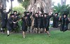 Graduates of the UH law school's Evening Part Time Program jump for joy at a graduation ceremony on May 14 at Andrews Amphitheater. Photos by Spencer Kimura and Mike Orbito