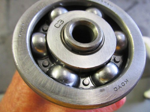 Output Shaft Front Bearing Snap Ring Fills In Void Between Inner Race and Shaft