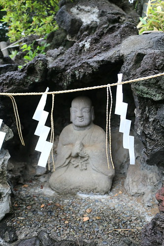 Statue of an ascetic in a cave on a mini-Fuji in Tokyo