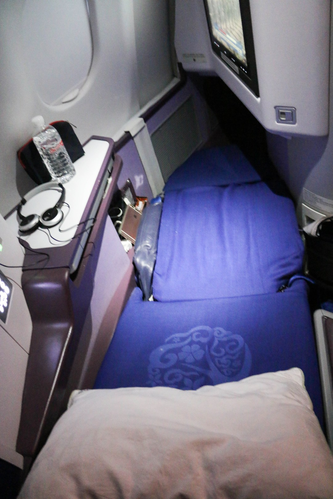 Business class seat in flat bed mode