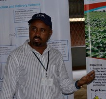 Dr.-Arega-explaining-about-the-project-during-a-visit-by-the-USAID-team-to-IITAs-display-Copy