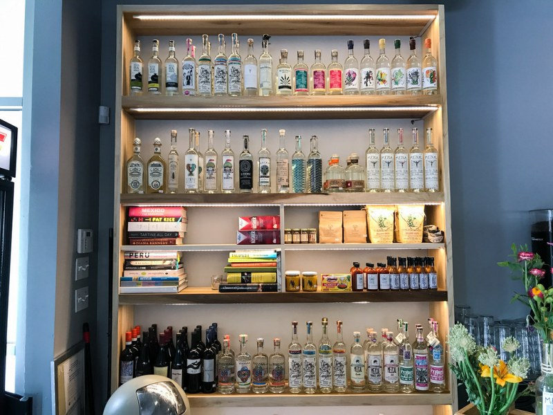 Quiote shelf with various items available for purchase