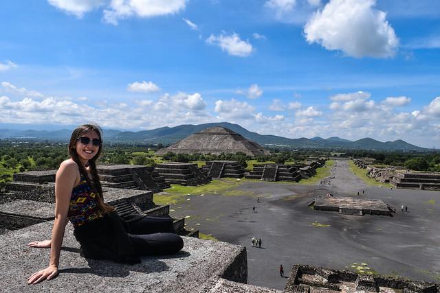 Briana atop the Pyramid of the Moon looking towards the Pyramid of the Sun