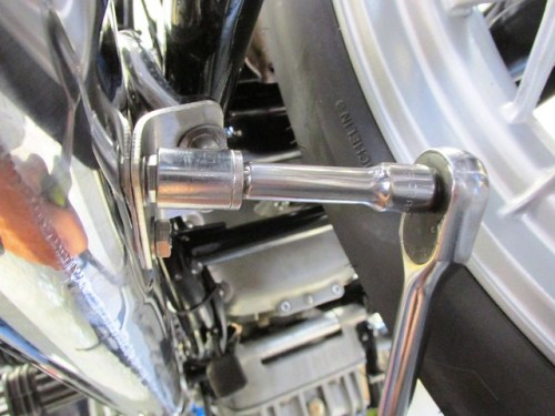 Tighten Angle Bracket to Muffler