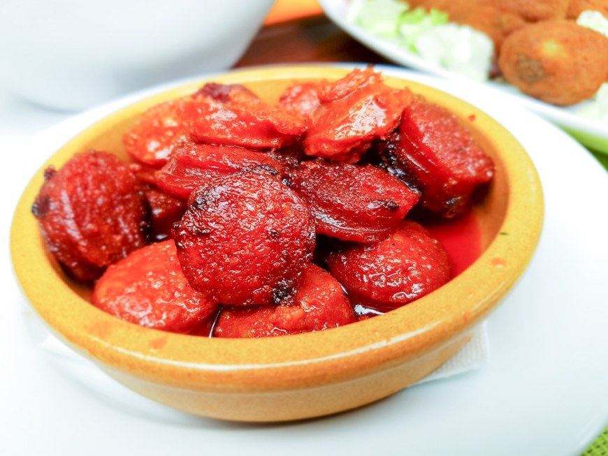 A bowl of chorizo in red wine
