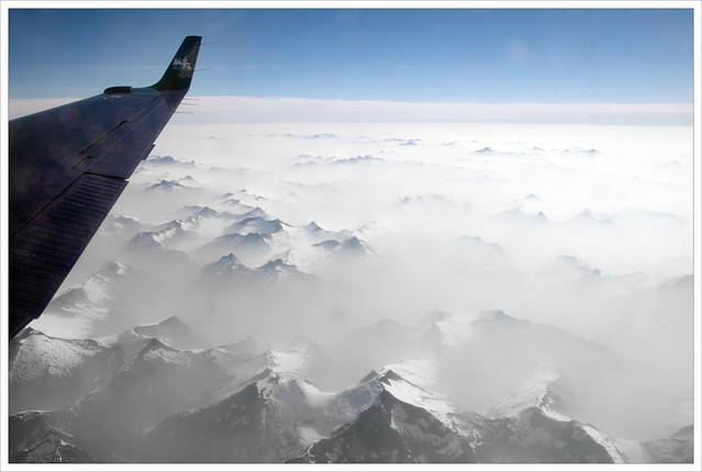 Mountains poking out of the smoke below