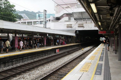 Northbound train in the 'loop' platform at Sha Tin, main line clear for a Through Train to overtake