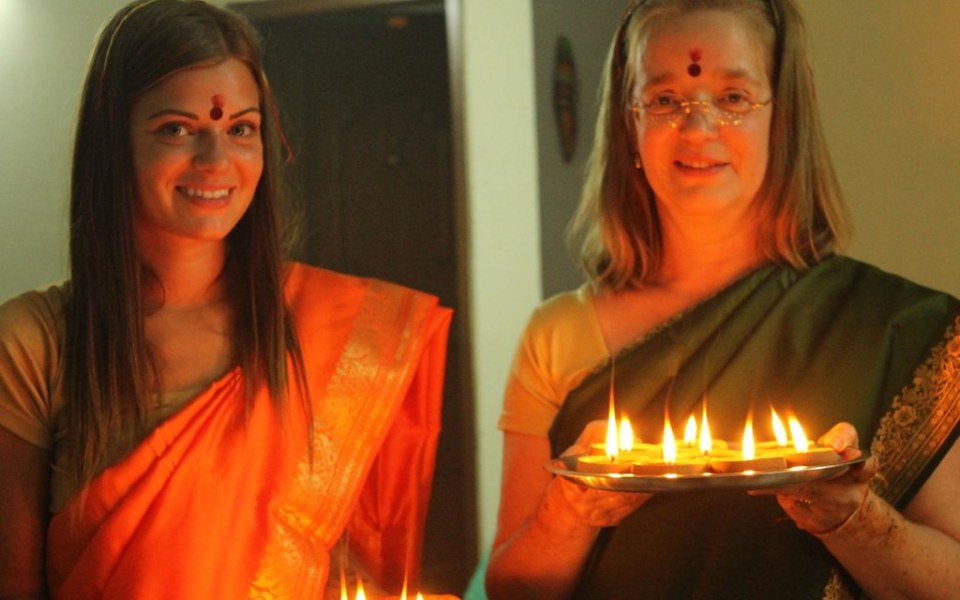 Lighting up diyas (earthen lamps)