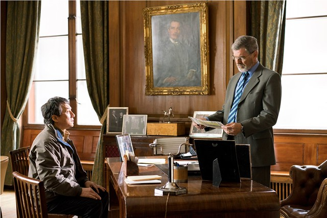 (Left to Right) Jackie Chan as Quan and Pierce Brosnan as Hennessy at Hennessy's office in THE FOREIGNER