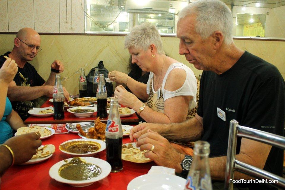 Dinner of Saag Chicken, Mutton Curry, Kofta and various breads at Kake Da Hotel