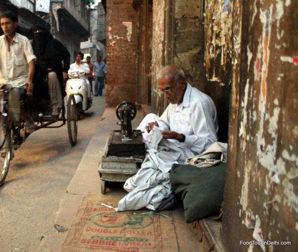 A roadside tailor in Old Delhi