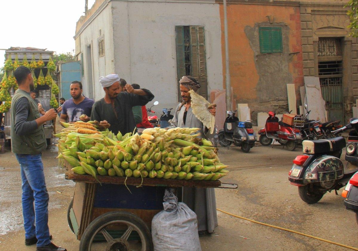 Corn seller facing coal