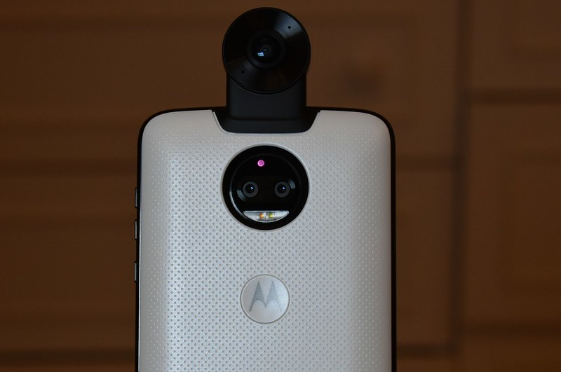 Moto Z2 force with Moto 360 camera with M logo as trigger button