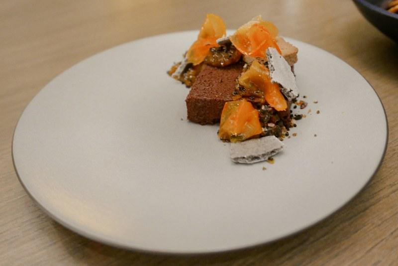 Chocolate Pave, flourless chocolate brownie, burnt persimmon marmalade, yuzu, crispy black sesame, forbidden rice ($12)