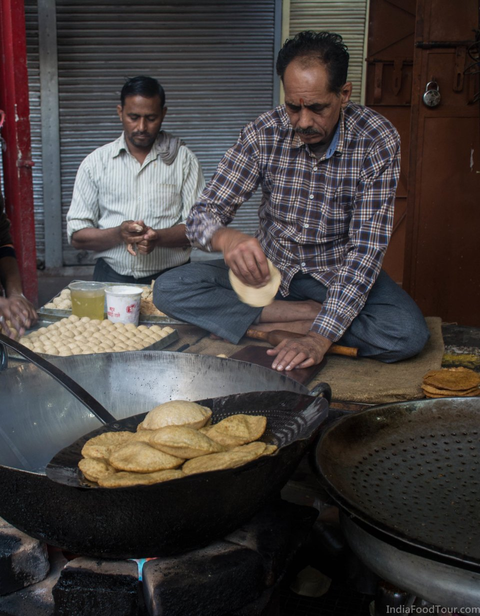 Workers making the same puris as above