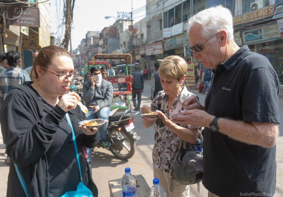 Tasting aaloo tikki with chutneys