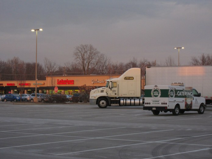 Dusky strip mall with trucks