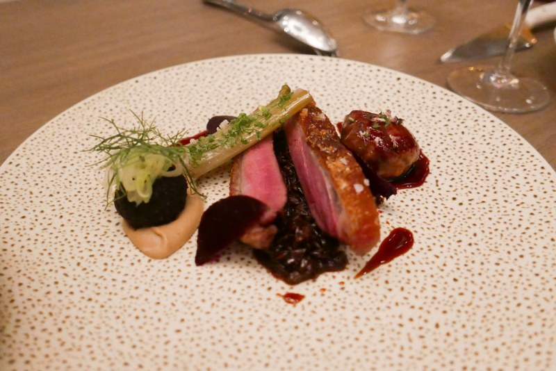 Dry Aged Duck glazed with burnt honey, fennel, braised farro, roasted beets, duck heart en crépinette ($36)