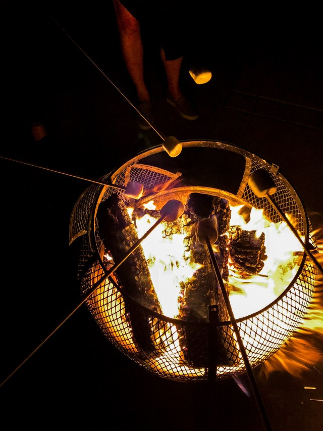 roasting s'mores on the patio under the stars
