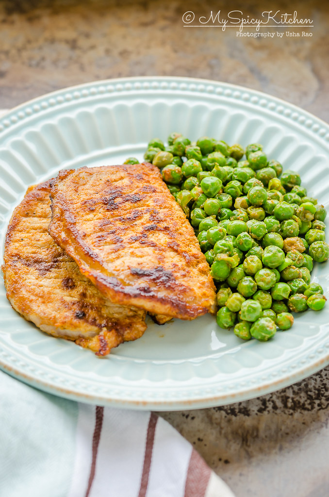 Plated 3 ingredient pork chops with english peas
