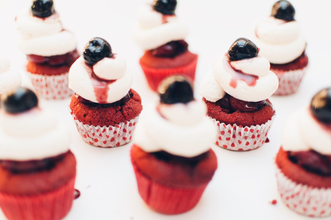 red velvet cherry bombs with cream cheese frosting and maraschino cherries