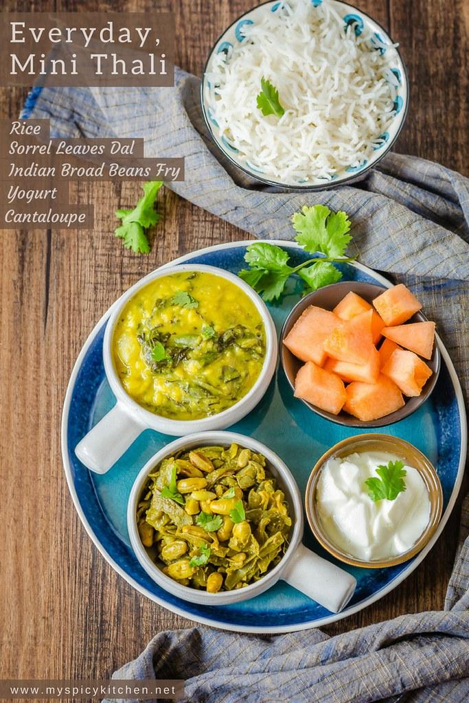 An everyday mini thali or a platter of everyday meal consisting of chikkudukaya kura, sorrel leaves dal, rice,  yogurt and cantaloupe.