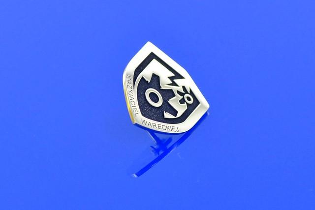 pins warecka -mosiądz polerowany