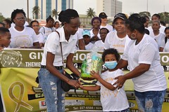 A young cancer survivor receives a token from the Giving Hope Foundation.