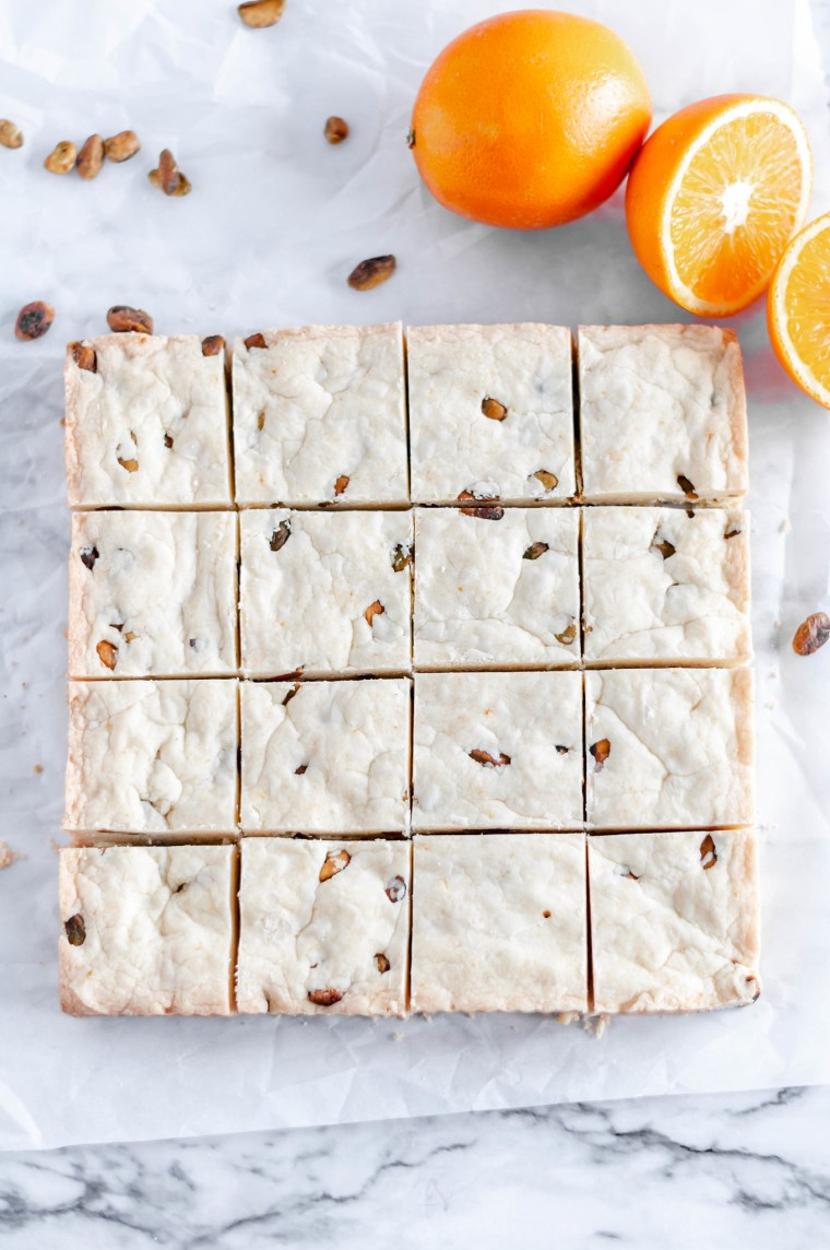 Orange Pistachio Shortbread Bars are a delicious, festive and simple cookie bar that you need to make this Christmas. Melt in your mouth delicious and oh so buttery.
