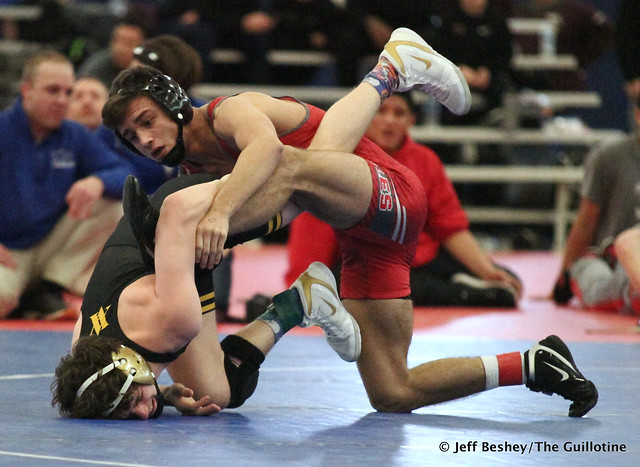 132 Semifinal - Noah Villarreal (Aurora Christian) 15-1 won by major decision over Adam Mickelson (Apple Valley) 11-7 (MD 21-8). 181215AJF0312