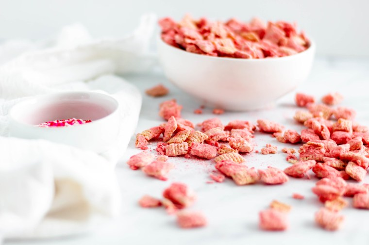 Make your Valentines Day festive with this Coconut Strawberry Puppy Chow. White chocolate, freeze dried strawberries & coconut are such a sweet combination.