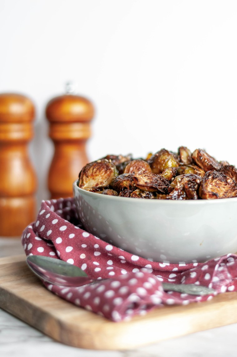 Thai Sweet Chili Brussels Sprouts are going to be your new favorite Thanksgiving side dish. Roasted in the oven to crispy, sweet perfection.