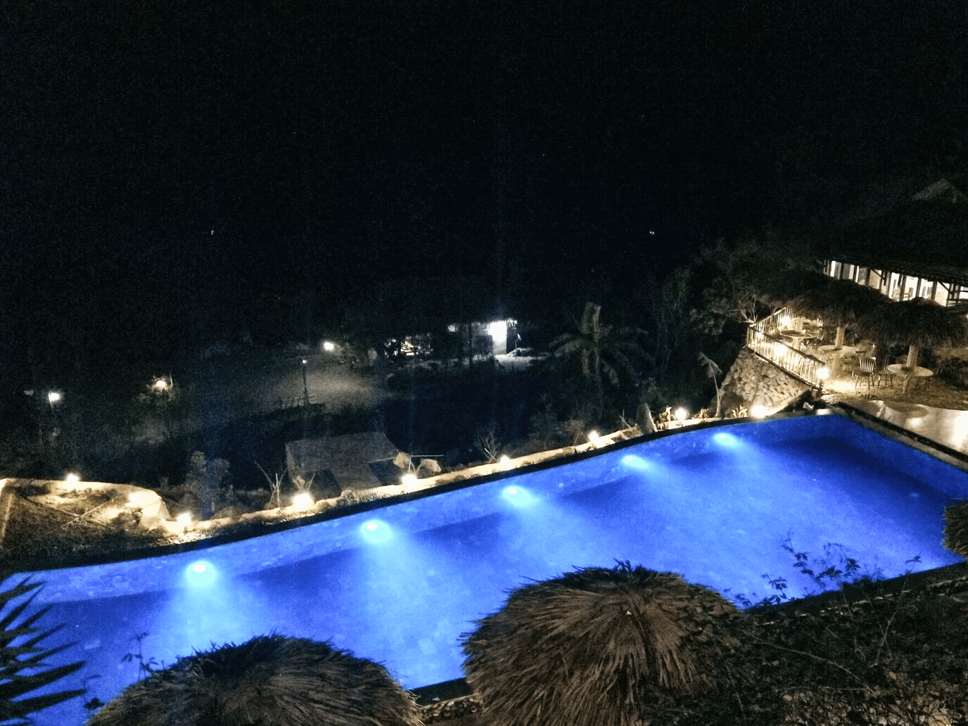 pool at night at the eco garden
