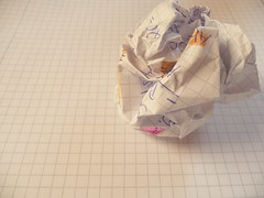 writer's block - crushed and crumpled paper on...