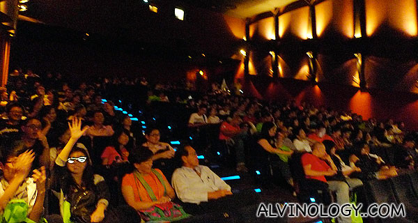 Cheerful audience, waiting for the movie to start