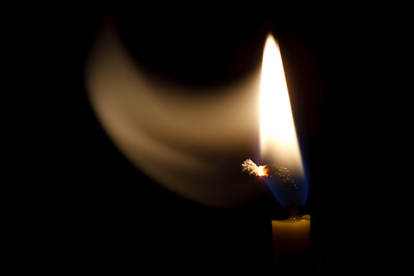 A ghostly candle flame.