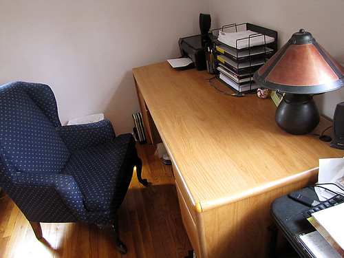 Project Simplify week 2 - Paper cluttered desk after