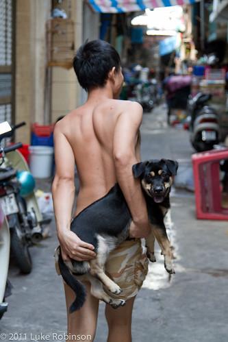 A boy and his dog, near Ben Thanh market