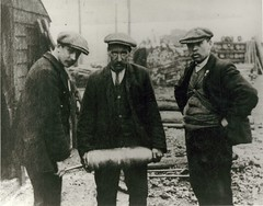 Three men with shell