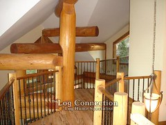 Wrought Iron Rail in a Log Post & Beam Home
