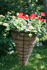 Cone shaped planter with red Petunias and Lantana