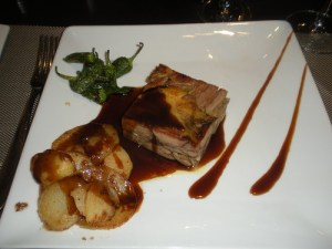 Roast shoulder of lamb with veal trotters and potatoes with lemon